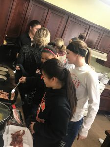 Lady Tigers help housing residents