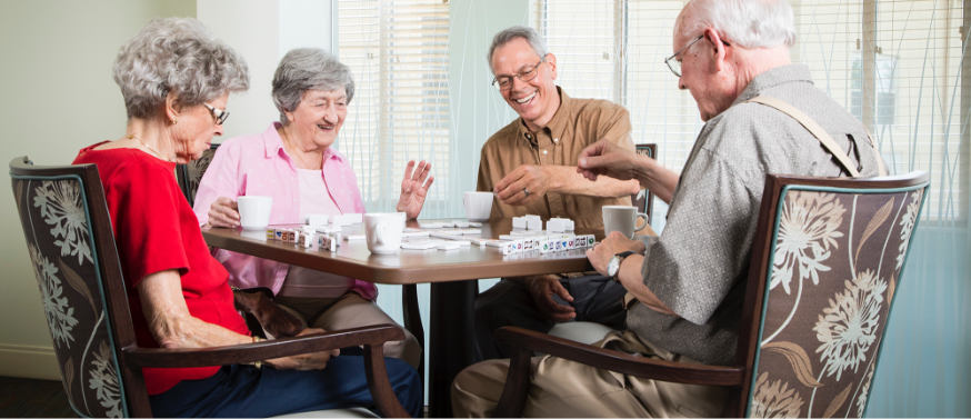 Bethany Village - residents playing dominoes at a table